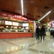 Stock Video: Buyers visit food in shopping center European