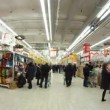 Stock Video: People make purchases in shopping center European