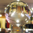 New Year cafe is reflected in transparent ball — Stock Video
