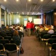 Stock Video: Lot of people sit in conference hall during Game Developers Conference 2011