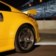 Yellow sport car stand at background of bridge at night — Stock Video