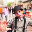 Bloody zombie mime walk by street among people during Zombie Parade — Stock Video