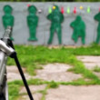 Paintball gun and targets in outdoor shooting gallery — Stock Video #30656491