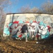 Teenager draw graffiti on wall in autumn on Losinyj island — Stock Video