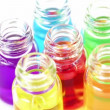 Six transparent open bottles spins with color oil on them — Stock Video #30656601