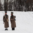 Stock Video: Two soldiers of Russian army 19th century go on attack with guns to camera at historical reconstruction