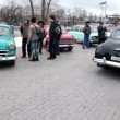 Stock Video: Several people stand near old cars in park at Opening of retro-season