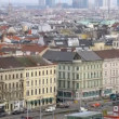 Stock Video: Viennese Danube tower stands against city landscape above roofs of houses