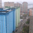 Stock Video: Skyscrapers stand in front of housing estate Crimson Sails