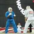 Stock Video: Judge separates sportsmans Goksel from Turkey and his opponent fighting at World Cup 2011 KUDO