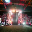 Gate of metal constructions with illumination, guitarist and drummer on sides — Stock Video