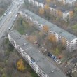 Old five-floor houses stand near to highway on which cars rush — Stock Video #30657229
