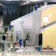 Several workers build house in exhibition hangar — Stock Video