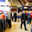 People walk around exhibition hall during Game Developers Conference 2011 — Stock Video #30657361