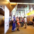 Young models and many visitors on exhibiton during Game Developers Conference 2011 — Stock Video #30657517