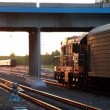 Stock Video: Train ride under bridge with car passes by
