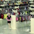 Stock Video: Two women walk in clothes shop with mannequins