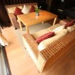 Wicker sofa stand in restaurant lounge fenced from of terrace by glass door with hangings — Stock Video #30657809