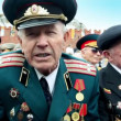 Stock Video: Veteran Shishkin V.I. speak about war at background of kremlin wall