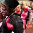 Bloody zombies crowd walk include newlyweds and bridesmaid — Stock Video