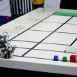 Referee watch on robot moves and stack at table — Stock Video