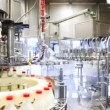 Lots of empty bottles washed and left appear already filled milk at huge factory, wide view — Vídeo Stock #30658035