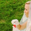 Bride in white starts up soap bubbles on meadow — Stock Video #30658081