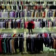 Several women watch goods among lot of clothes in shop — Stok video
