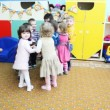 Stock Video: Nice kids holding hands, standing in circle converge and diverge in Moscow kindergarten 143