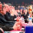 Stock Video: Jury sit at table near boxing ring at Battle of Moscow 3