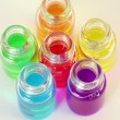 Six transparent open bottles rotates with color oil on them — Stock Video #30658235