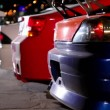 Stock Video: Three cars with colorful sport design at night