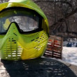 Yellow helm for paintball lay at background of playground — Stock Video