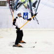 Skier sportsman sitting on handle goes up hill in sport center — Stock Video