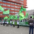 People waving large flags on demonstrate AGAINST CORRUPTION on Sakharov Ave — Stock Video #30658995