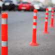 Protective barrier made of striped columns, people and cars go road — Stock Video #30659047