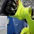 Huge robotics part for cars assemblage stand in large hangar — Stock Video