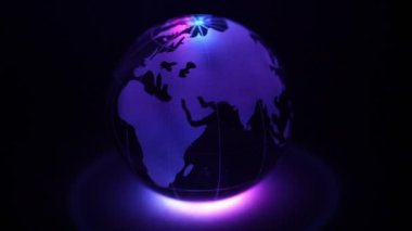 Glass Earth sphere with color illumination — Stock Video