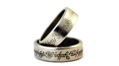 Two silver wedding rings with engraved ancient inscriptions rotating — Video Stock