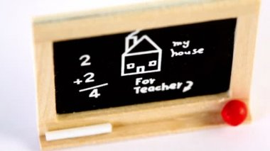 Toy blackboard circling with drawing, inscription and computation — Stock Video