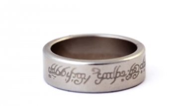 Silver wedding ring with engraved ancient inscriptions rotating — Video Stock