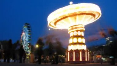 People ride on shone chairoplane in night — Stock Video