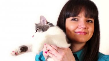 Young girl hold cat on hand — Stock Video