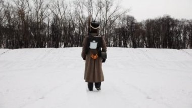 Soldier of Russian army 19th century leaves marching snowy winter field — Stock Video