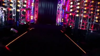 Gate of metal constructions with colorful illumination, motion inside — Stock Video