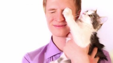 Young boy hold cat on hand — Stock Video