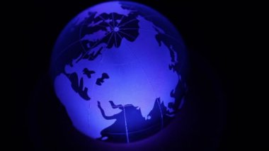 Glass sphere with world map on it and color illumination — Stock Video