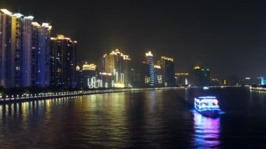 Tourist steamships swim on Pearl river at night against buildings — Stock Video