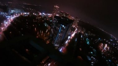 City is shone by light in windows of houses and cars through wet glass from rain — Stock Video