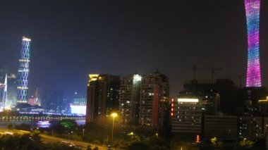 Twin Tower and TV Tower stands on against city landscape in night — Vídeo stock